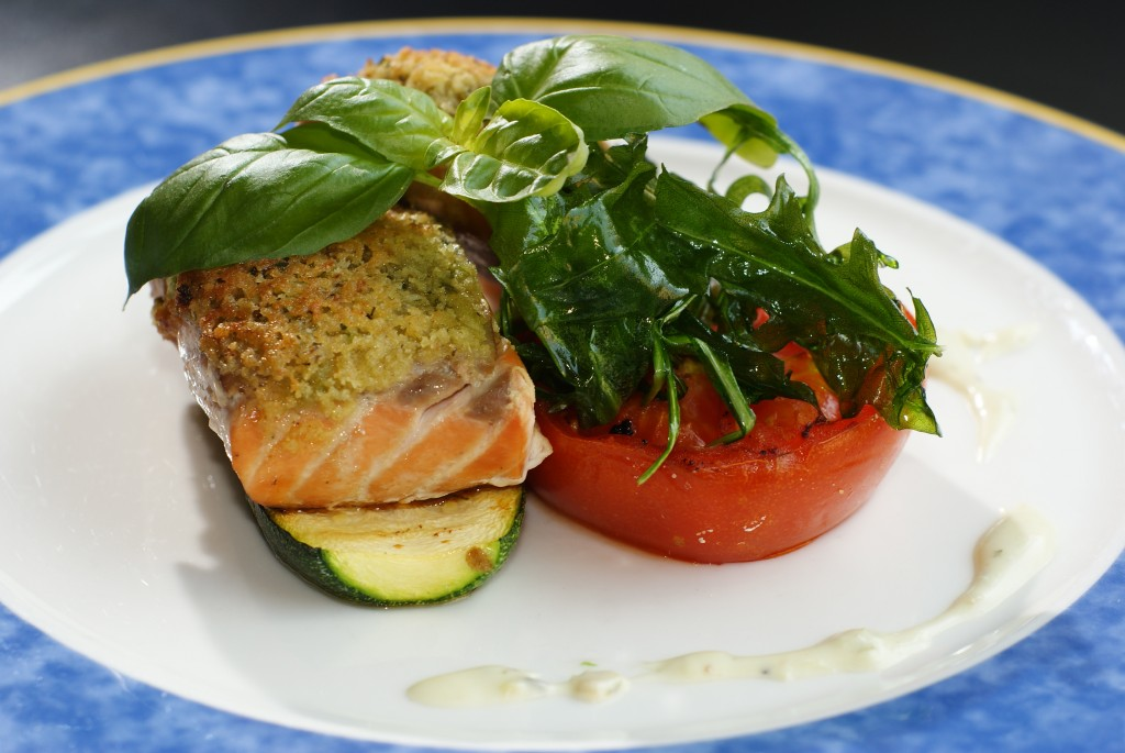 Salmon over grilled zucchini and tomato basil salad