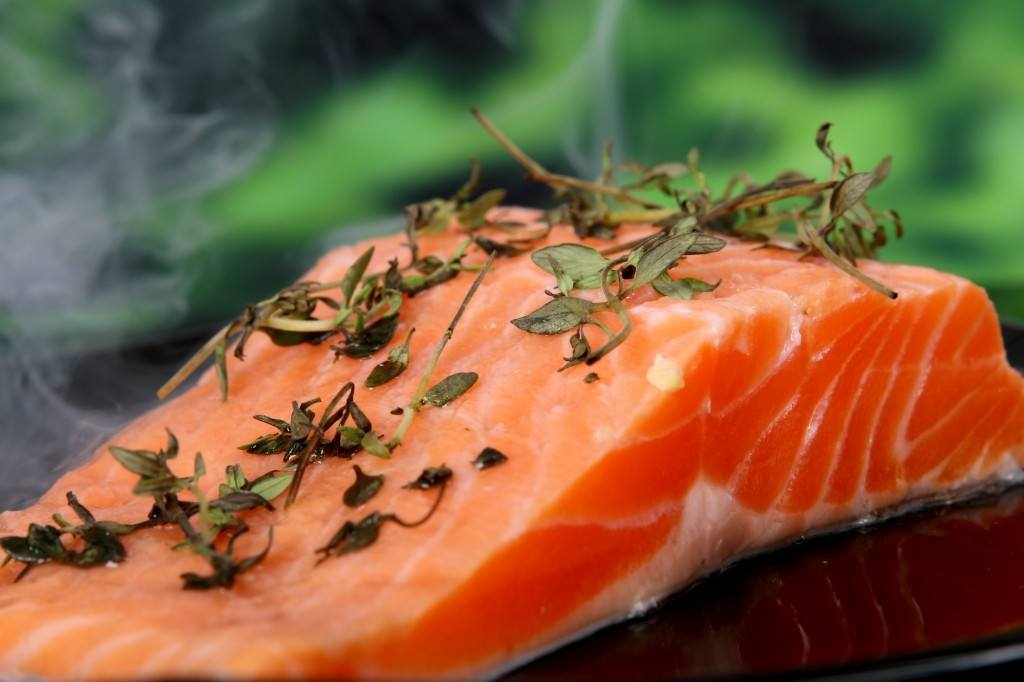 Summer food, salmon steak with herbs